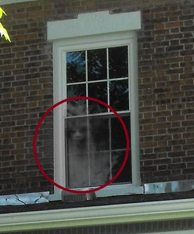 Angry Ghost Looknig Out Window
